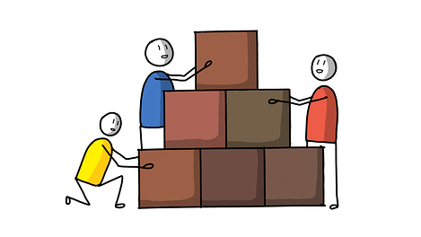 Three people building wall together